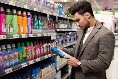 Man looking at packaging information