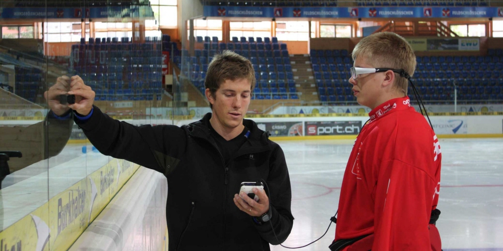 A calibration of Tobii Pro Glasses 1  at a hockey arena.