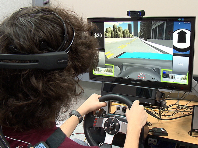 ). A Pilot Study Assessing Performance and Visual Attention of Teenagers with ASD in a Novel Adaptive Driving Simulator