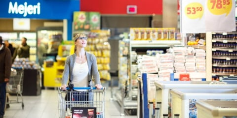 A woman wearing Tobii Pro Glasses 2 navigates through the grocery shop
