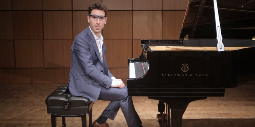 Professor Daniel Beliavsky wearing Tobii Pro Glasses 2 while playing piano