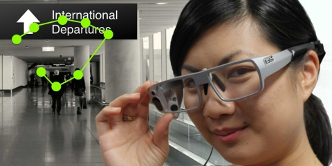 A person wearing Tobii Pro Glasses 1 navigates in the airport.