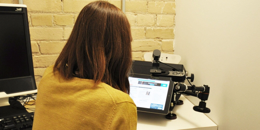 A person running an eye tracking test using Tobii Pro X60 eye tracker.